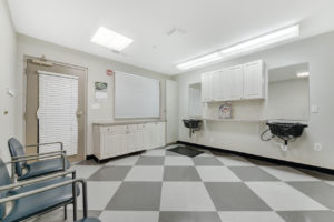 hair salon with hair sinks and cabinets