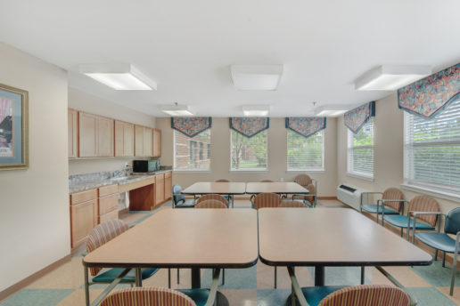 community room with tables and chairs, microwave