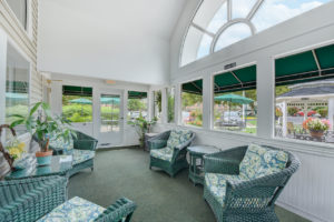 bright community room with large window and seating area